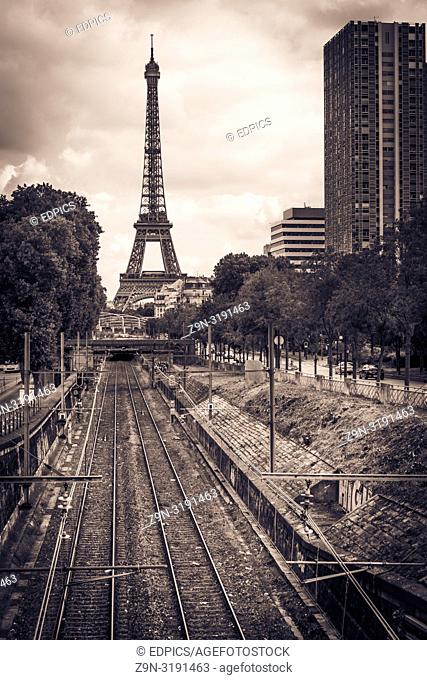 eiffel tower, railroad tracks and high-rise residential buildings, paris, ile de france, france