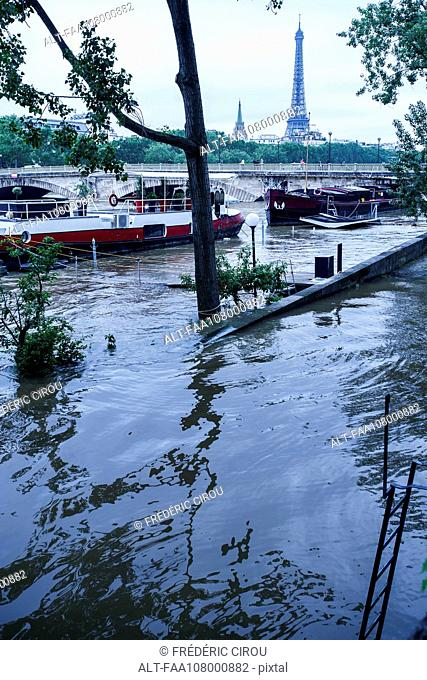 Flooded bank of the Seine River in Paris, France