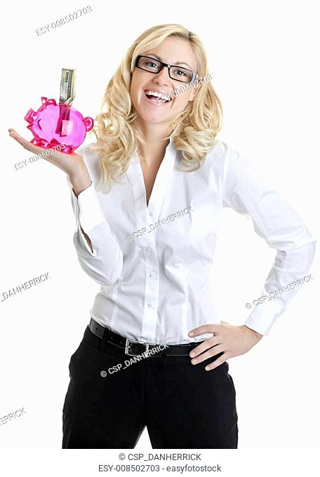 Cheerful young executive holding paper currency in piggy bank