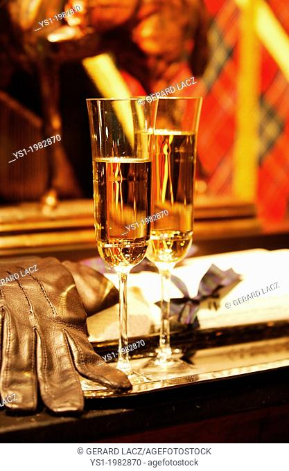 Glasses of Champagne with Leather Glove