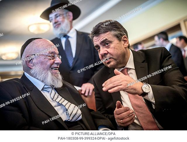 08 March 2018, Germany, Berlin: German Foreign Minister Sigmar Gabriel (R) of the Social Democratic Party (SPD) speaking to the rabbi Dayan Chanoch Ehrentreu...