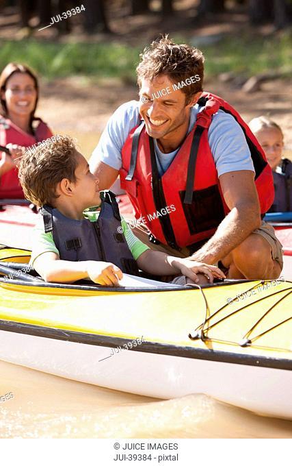 Family in kayaks