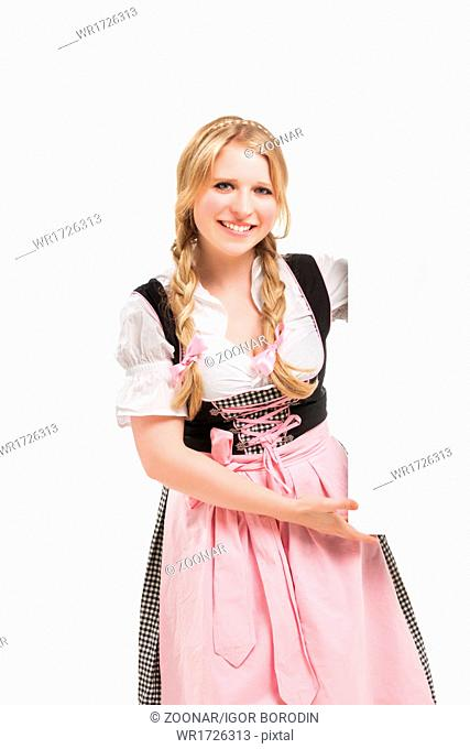 Bavarian woman in dirndl, holding blank signboard