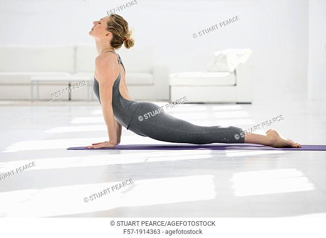 Woman doing the upward-facing dog yoga position