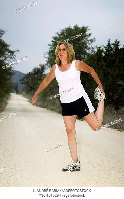 Mature woman at fitness exercise