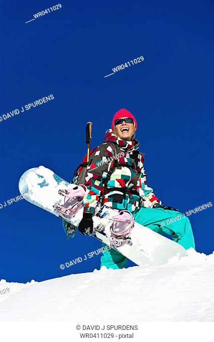 A snowboarder enjoying life on the mountain