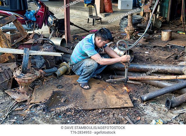 Metal worker, Hoi An, Vietnam