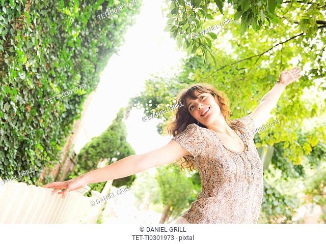 Woman dancing in park