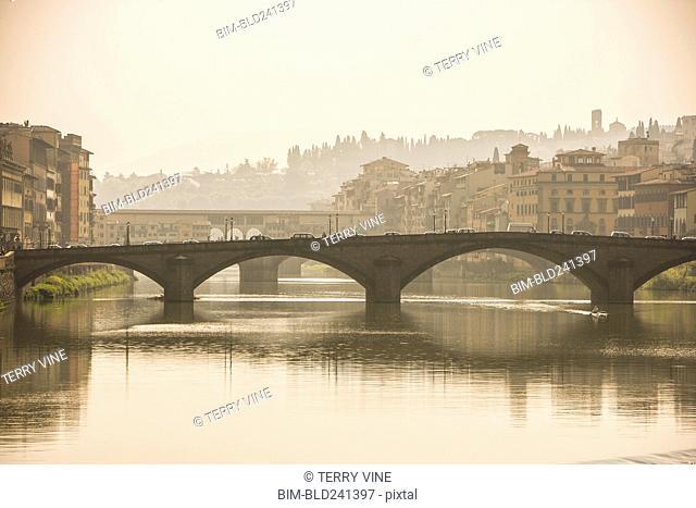 Cars crossing bridge over river