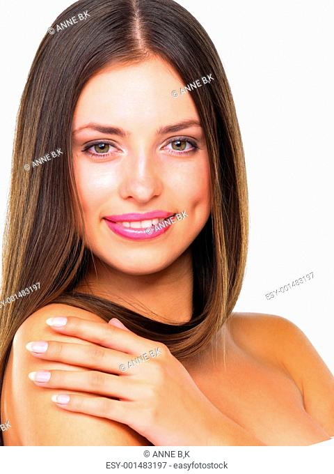Closeup of glamorous young woman with pleasing smile over white background
