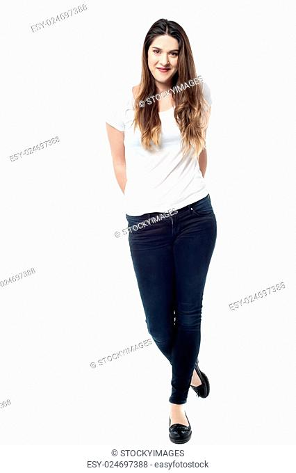 Full length of woman with arms behind her back