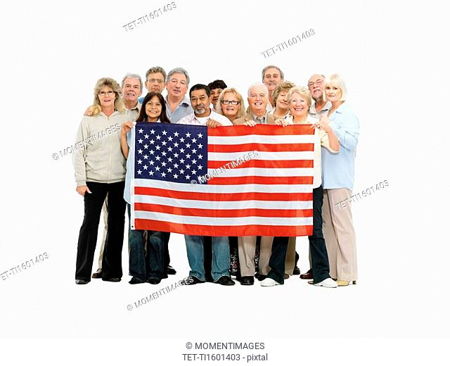 Group of people holding an American flag