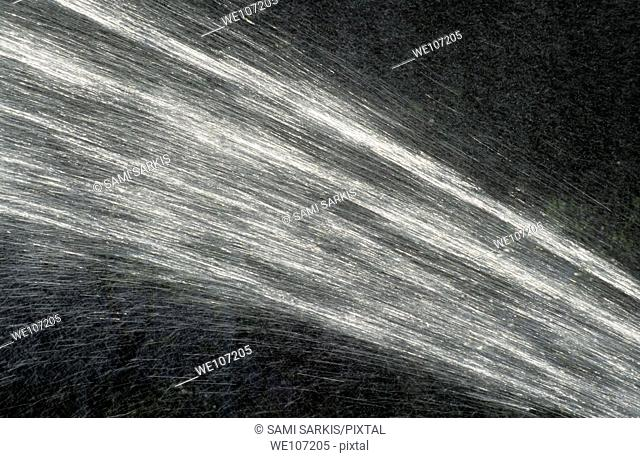 Forceful spray of water