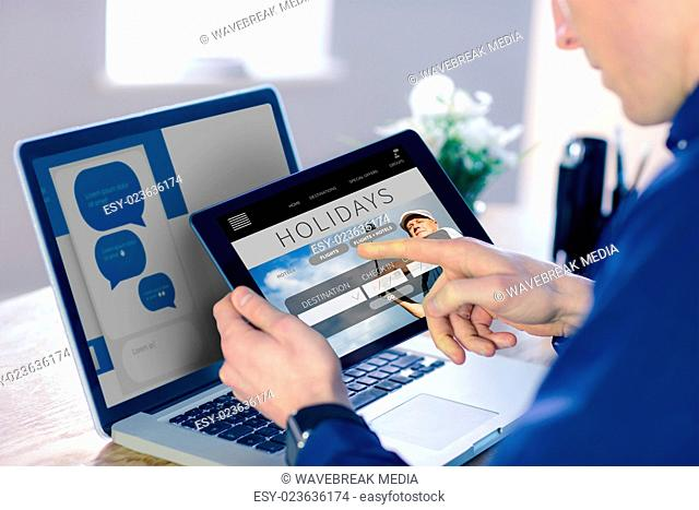 Composite image of businessman using tablet computer in office