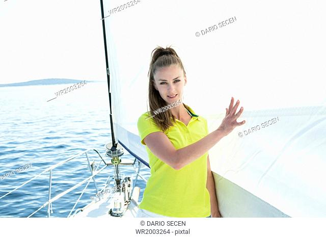 Young woman on sailboat, Adriatic Sea