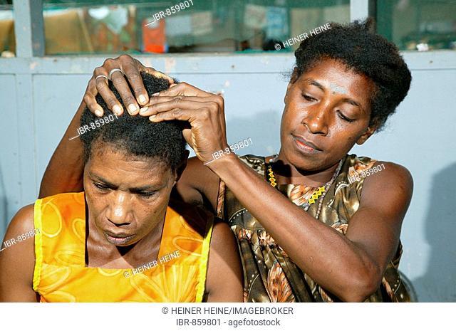 Head massage in the hospital, Butaweng, Papua New Guinea, Melanesia