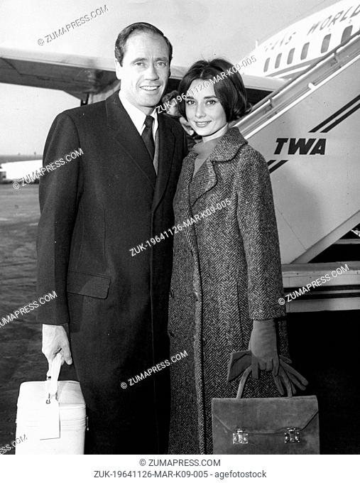 Nov. 26, 1964 - New York, NY, U.S. - Actor MEL FERRER and his wife, actress AUDREY HEPBURN add a touch of glamour following their arrival at the Idlewild...