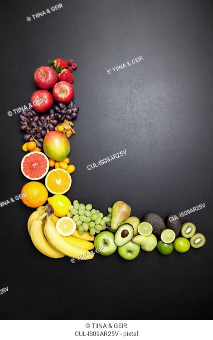 Overhead still life of variety of fresh fruit arrangement