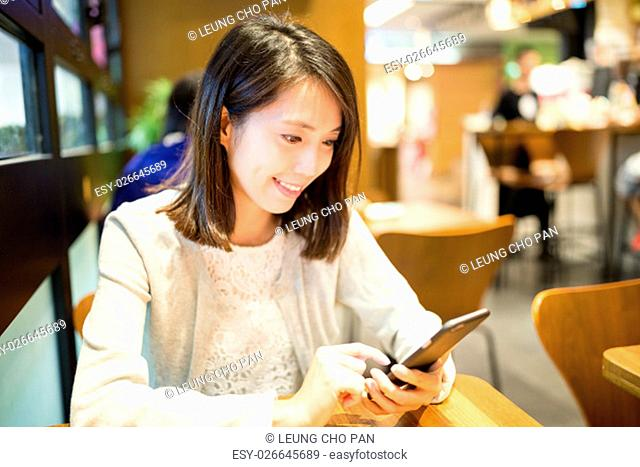 Woman use of cellphone at cafe