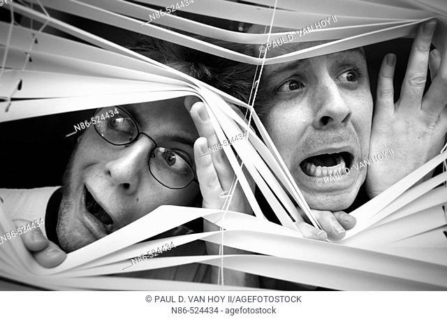 Humor, two scared men in window