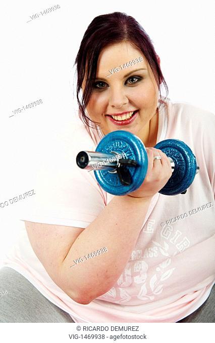 AUSTRIA , VIENNA , 11.01.2009, Young, fat woman training with weights - Vienna, Vienna, AUSTRIA, 11/01/2009