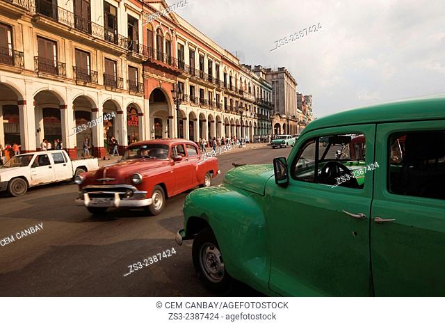 Old american cars and people in the city center, Havana, Cuba, West Indies, Central America