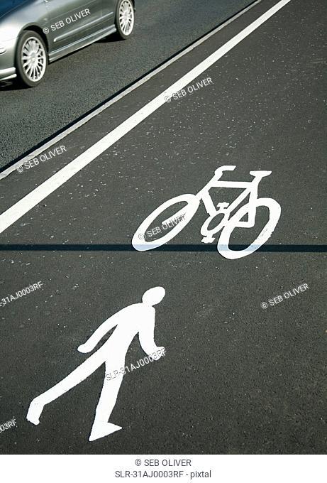 Cycling lane symbol and car