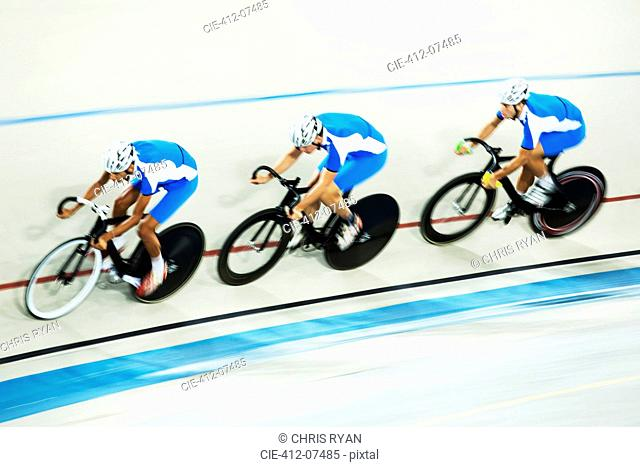 Track cycling team racing in velodrome