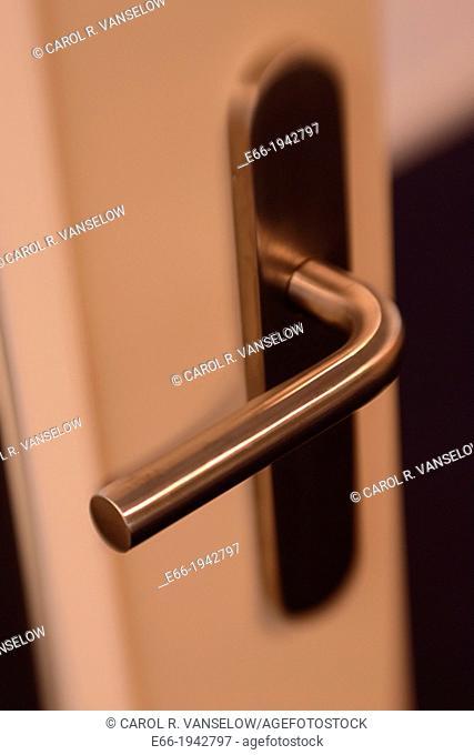 Silver door handle, white door