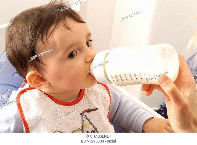 INFANT DRINKING FROM BABY BOTTLE Model