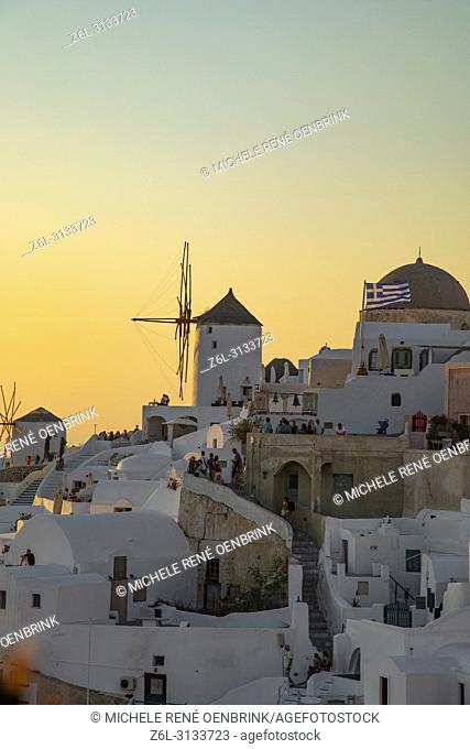 Sunset with windmill in Oia, Santorini Greece