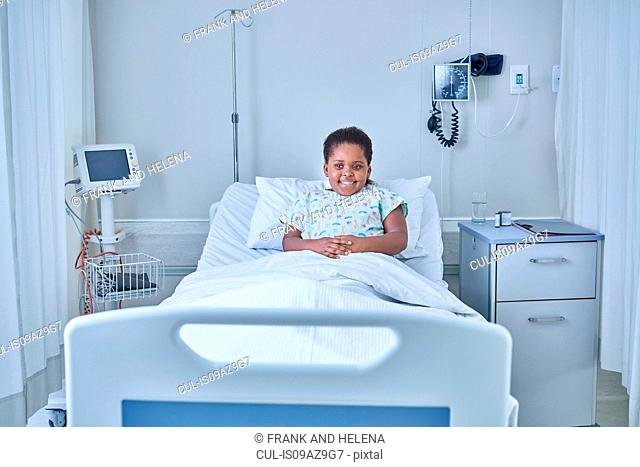 Portrait of girl patient in bed on hospital children's ward