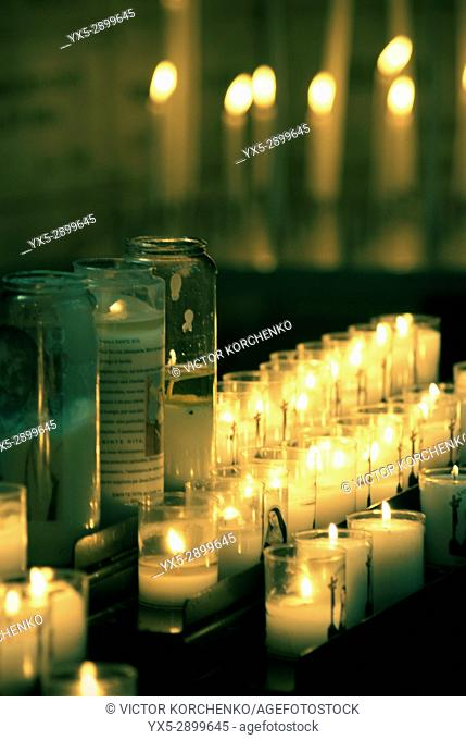 Votive candles burning in the church, Paris