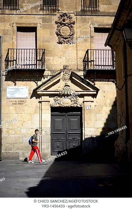 A student walks by the facade of the Casa del Regidor Ovalle Prieto in Salamanca, Spain. In this house lived and died Miguel del Unamuno, writer