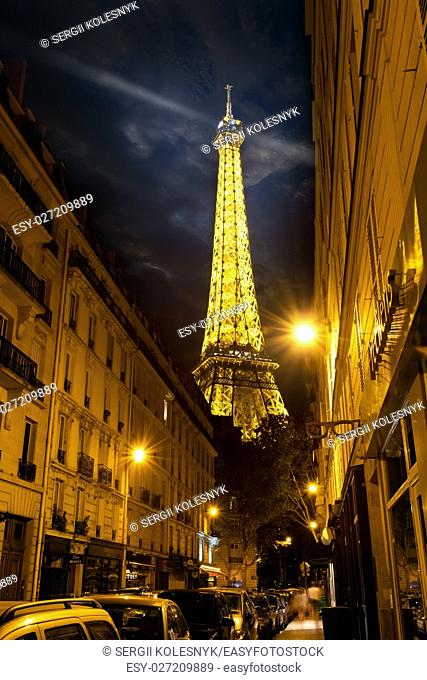 PARIS, FRANCE - AUGUST 25, 2016 : View on illuminated Eiffel Tower from Parisian street in the evening, France