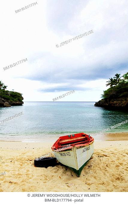 Canoe washed up on tropical beach