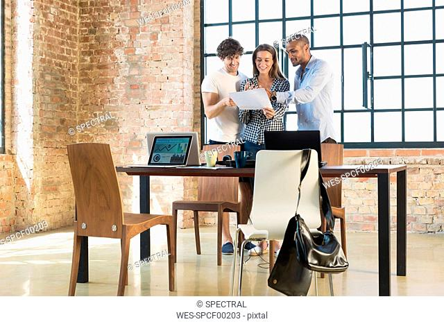 Young professionals working together in start up company, developing a business plan