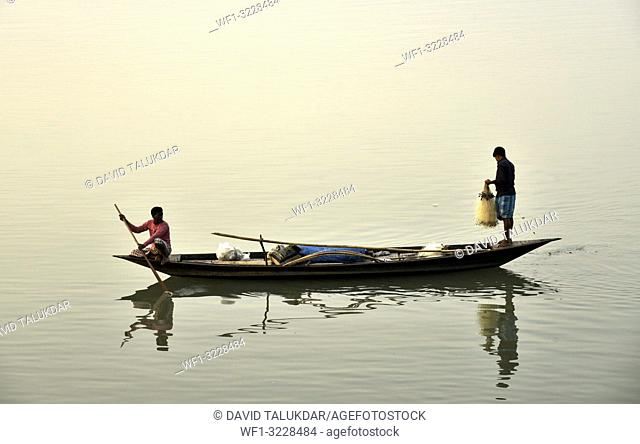 Guwahati, Assam, India. January 30, 2019. Fishermen lays their fishing net at the Brahmaputra River during sunset