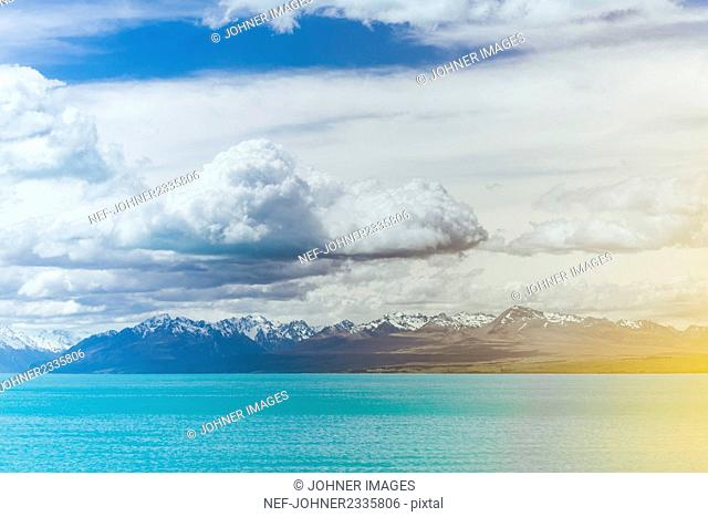 Clouds above coastal mountains