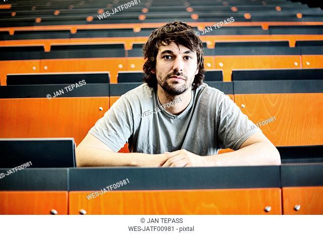 Portrait of student in auditorium at university