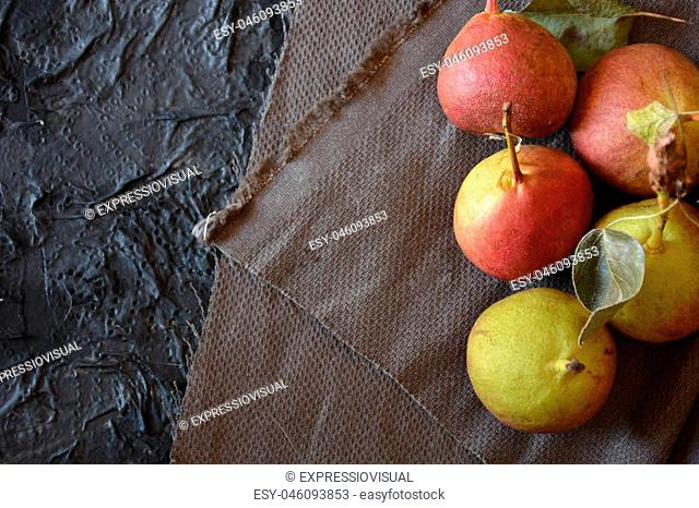 Pears of san Juan. Typical fruit Spanish of summer are put in dark stone table