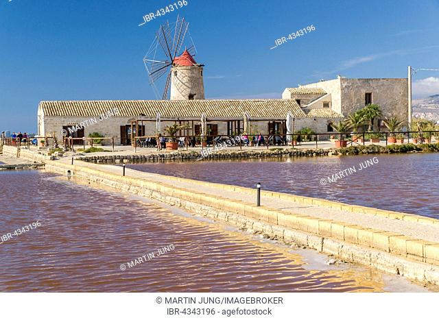 Windmill in Culcasi saltworks, Natural Reserve of saltworks with salt marshes, Via del Sale, Salt Road, Nubia, Province of Trapani, Sicily, Italy