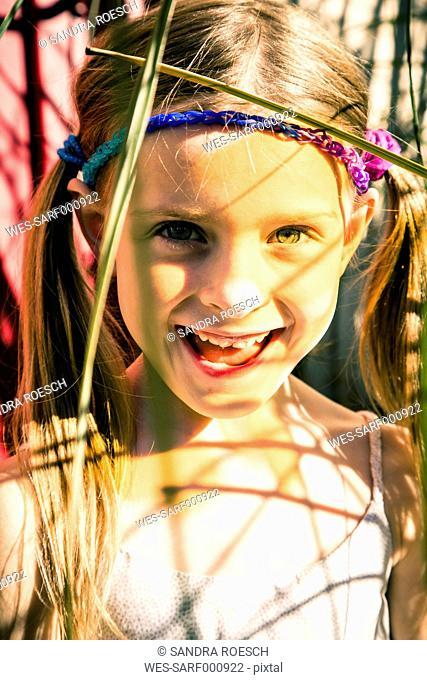 Portrait of smiling little girl in summer