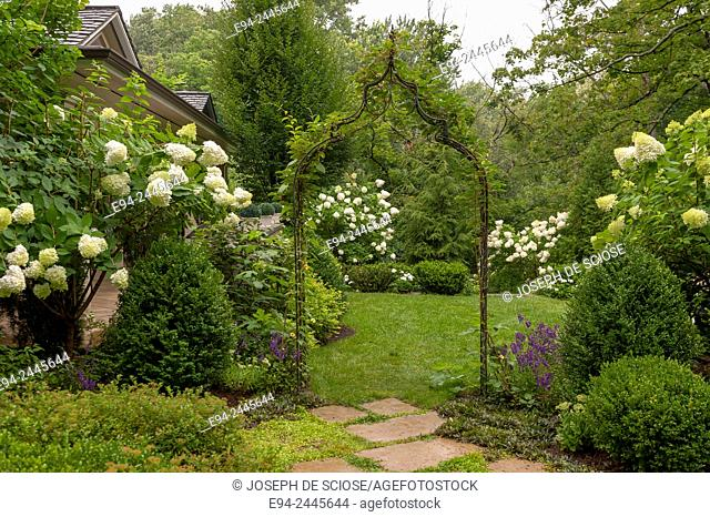 An arbor entrance in a garden featuring hydrangeas. Pittsburgh Pennsylvania USA