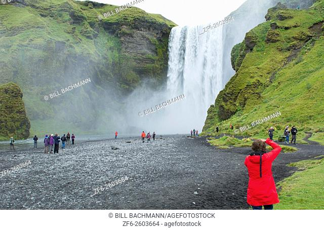 Iceland Skogafoss Waterfall famous falls in South Iceland at the Skoga River with tourist taking photos