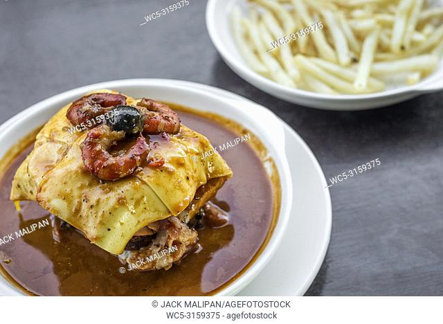 famous francesinha traditional meat cheese and spicy sauce grilled sandwich of porto portugal