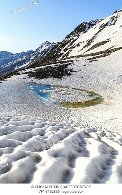 A small thaw lake under Sforzellina Peak. La valleta, Pejo valley, Trentino, Italy