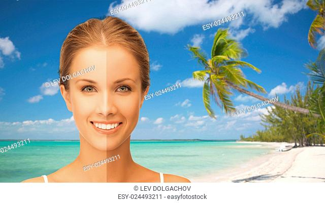 people, suntan, travel and summer holidays concept - close up of beautiful smiling woman with half face tanned over exotic tropical beach with palm trees...
