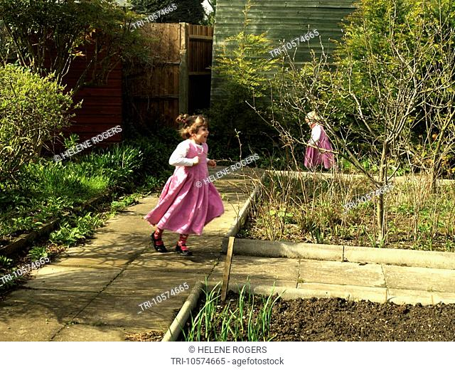 Sisters Aged Four and Two Playing in the Garden