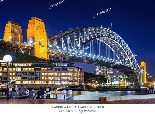 Sydney Harbour Bridge with Hyatt Park Hotel at dusk. Sydney, NSW, Australa